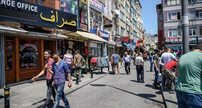 Syrian and Turkish people walk in a street next to shops with Arabic letters in Fatih district, Istanbul in this undated photo. AFP Photo