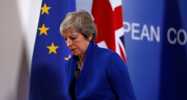 British Prime Minister Theresa May leaves the stand after a media conference in Brussels, Sunday, Nov. 25, 2018. AP Photo