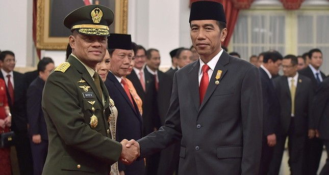 Indonesia's Military Chief General Gatot Nurmantyo (L) shakes hands with Indonesia's President Joko Widodo after the swearing-in ceremony at the presidential palace in Jakarta. (AFP File Photo)