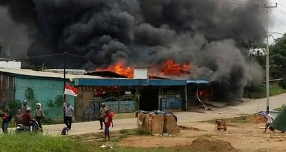 Hundreds flee Indonesia prison after violent riots