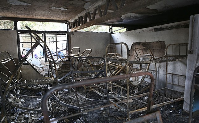 Metal bed frames are seen in a burned-out dormitory, following a fire at the Moi Girls High School in Nairobi, Kenya, Saturday, Sept. 2, 2017. (AP Photo)