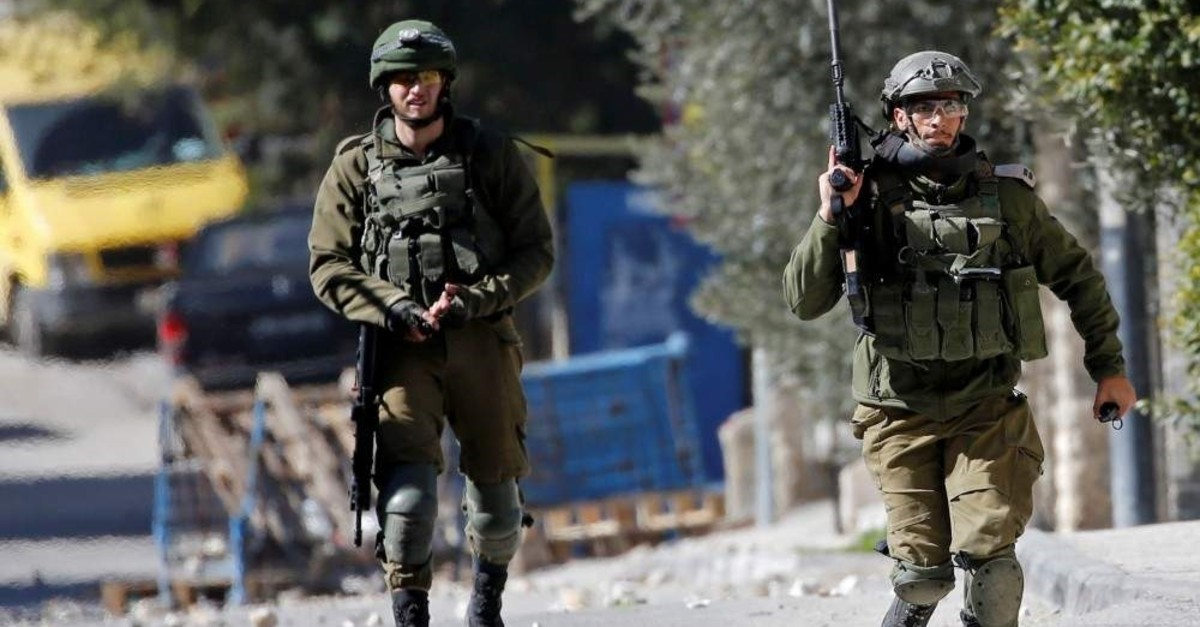 An Israeli soldier runs during a raid in Beit Jala in the Israeli-occupied West Bank, Feb. 6, 2020. (REUTERS Photo)
