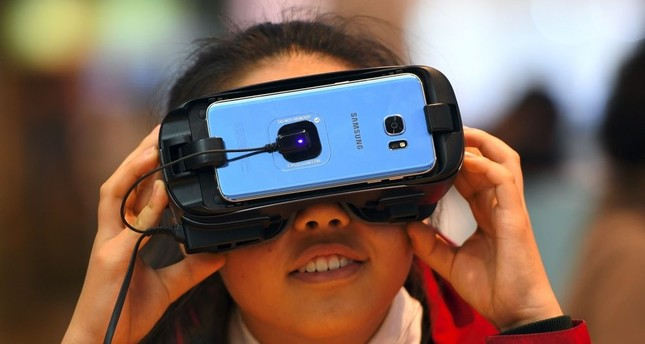 A girl experiences Samsung Electronics' Gear VR at its showroom in Seoul.