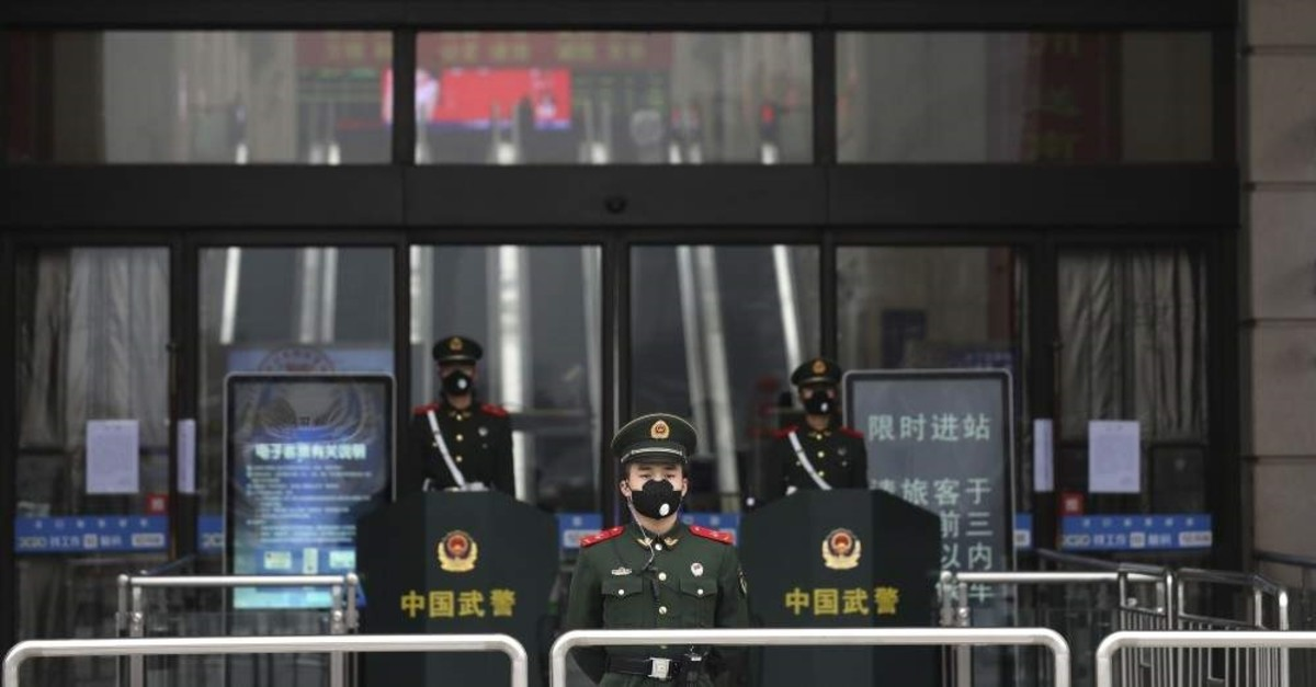 Chinese paramilitary police stand guard outside the closed Hankou Railway Station, Wuhan, Jan. 23, 2020. (AP Photo)