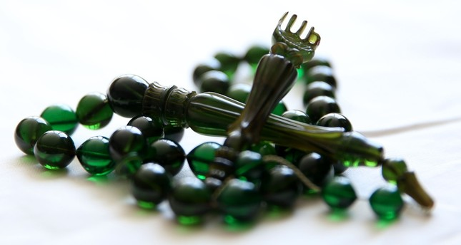 Turkish craftsman's hand-made prayer beads spread hope