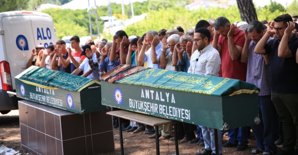 Relatives of Yu0131lmaz couple and their fellow villagers attend their funeral prayer in Akdamlar village, in Antalya, southern Turkey, on July 19, 2019. (AA Photo)