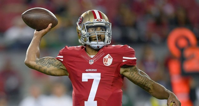 Quarterback Colin Kaepernick of the San Francisco 49ers throws a pass against the Green Bay Packers in the first half of their preseason football game at Levi's Stadium on August 26, 2016 in Santa Clara, California.emAFP Photo/em