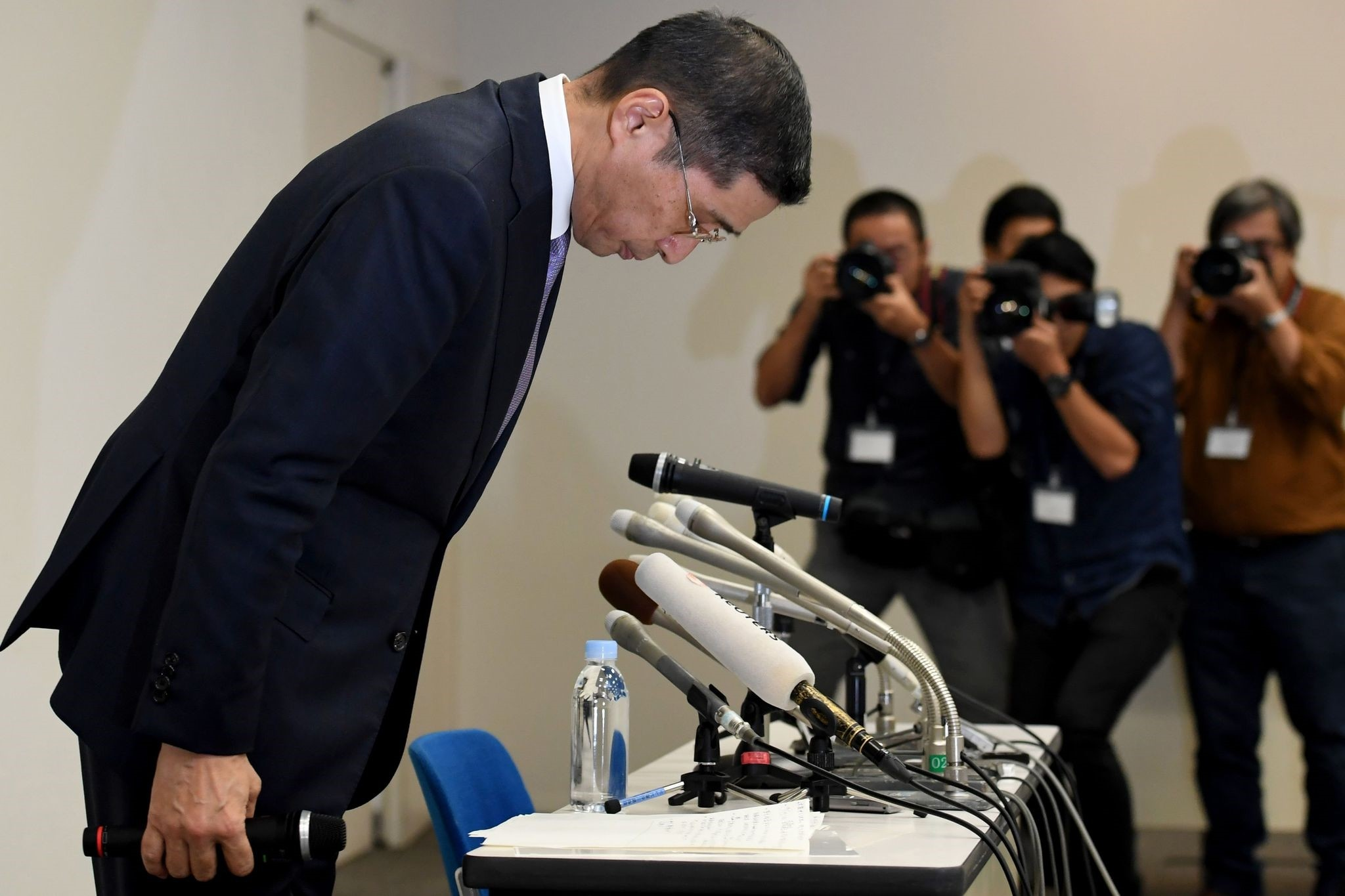 Nissan Motors CEO Hiroto Saikawa bows to start a press conference regarding the recent inspection issue in the Japanese market at its headquarters in Yokohama.