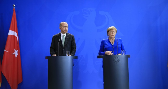 President Erdoğan (L) and German Chancellor Angela Merkel during a press conference in Berlin, Sept. 28.