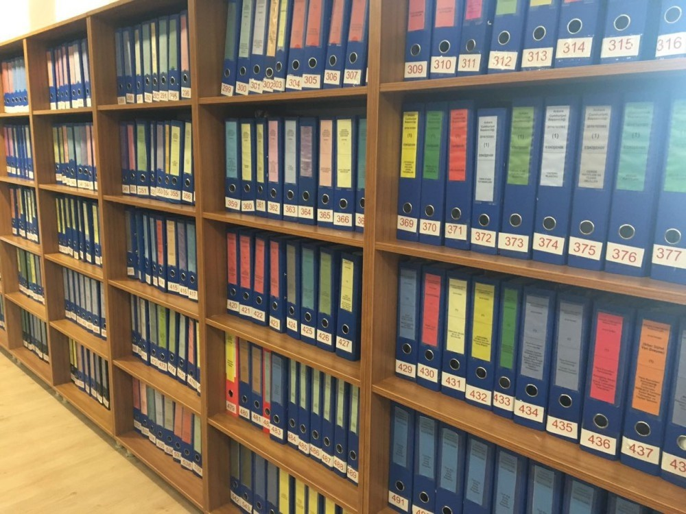 Hundreds of folders containing the indictment against FETu00d6u2019s coup attempt on the shelves at the Chief Prosecutoru2019s Office. Adil u00d6ksu00fcz (R) is one of the main suspects in the putsch bid he supervised in Aku0131ncu0131 base.