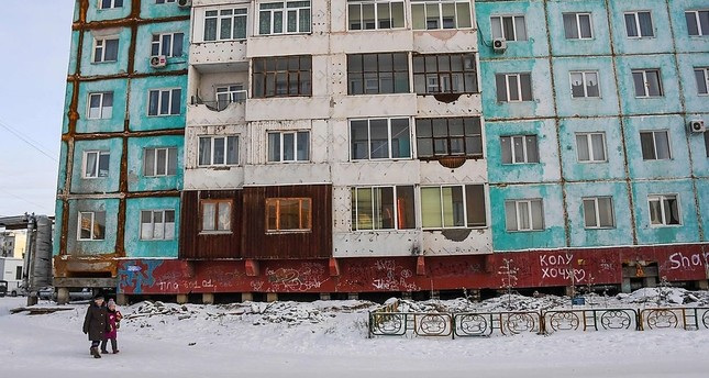 Older buildings in Yakutsk were not constructed with a warming climate in mind. (AFP Photo)