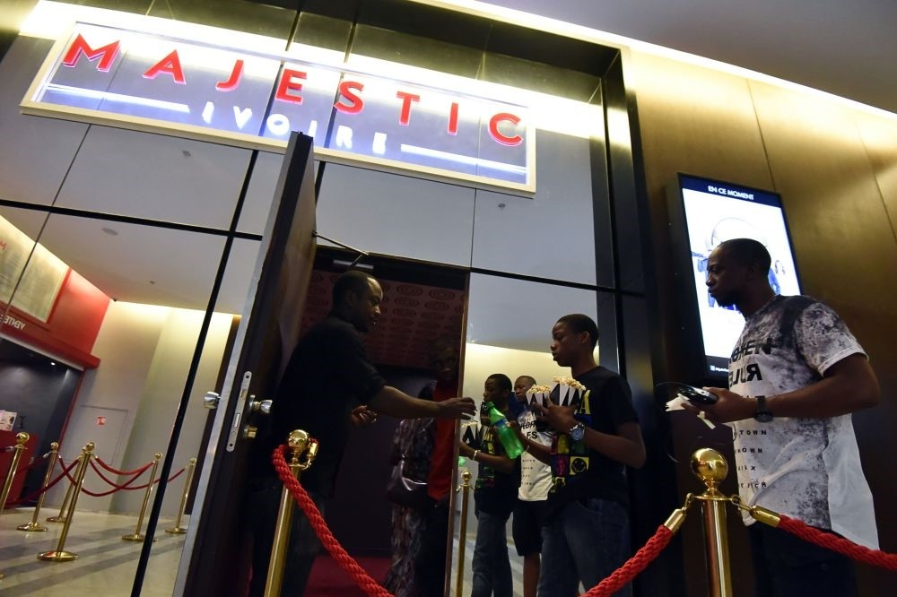 People queue to enter a screening room at the Majestic cinema in Abidjan. Like the plot in an old-fashioned movie, cinemas in Africa are making a third-reel comeback after years of worrying decline.