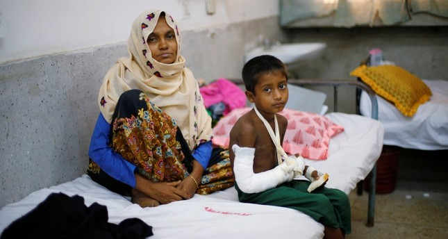 Faisal, 6, a Rohingya refugee who broke his hand while fleeing Myanmar, is treated at the Cox's Bazar District Sadar Hospital, Cox's Bazar, Bangladesh.