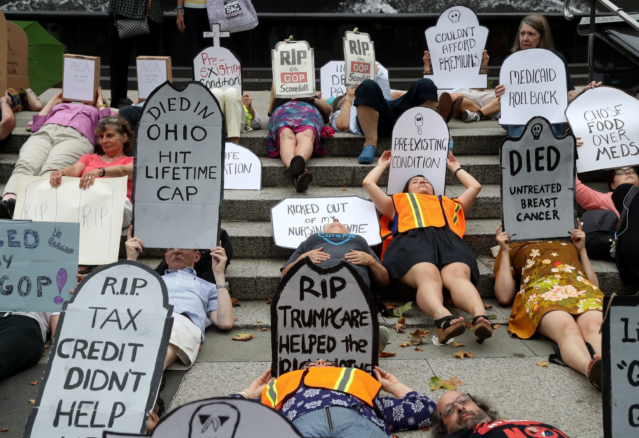 People participate in the Womenu2019s March Alliance Die in For Healthcare at Foley Square in New York, New York, 13 July 2017. (EPA Photo)