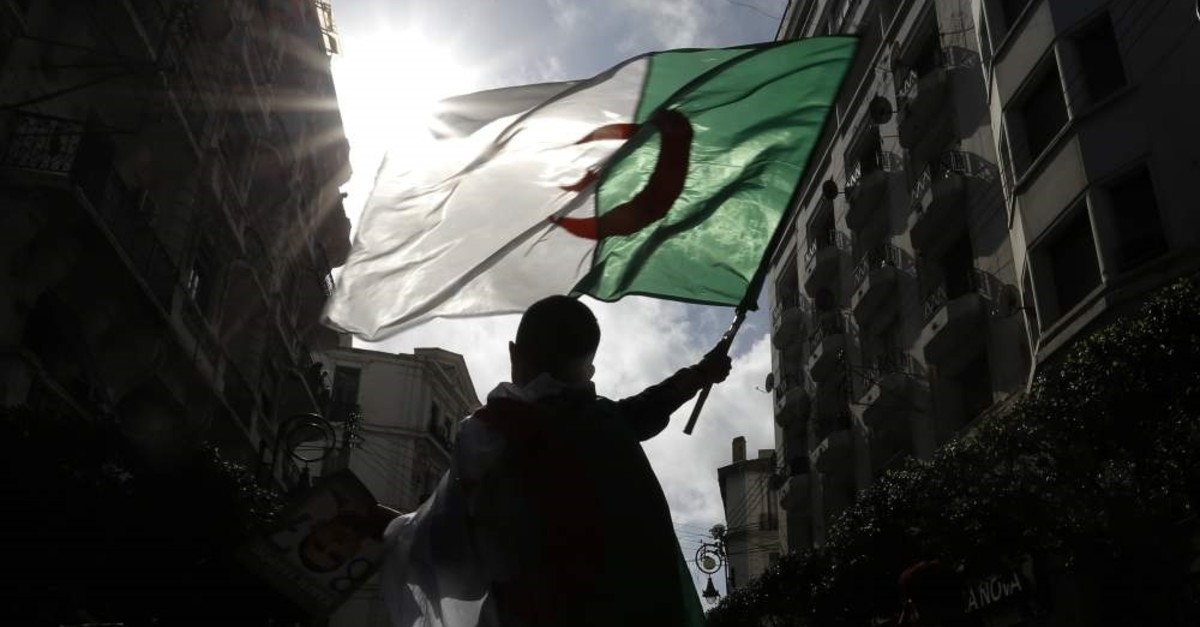 Thousands of Algerians take to the street to commemorate the first anniversary of the popular protests in Algiers, Algeria, Friday, Feb. 21, 2020. (AP Photo)