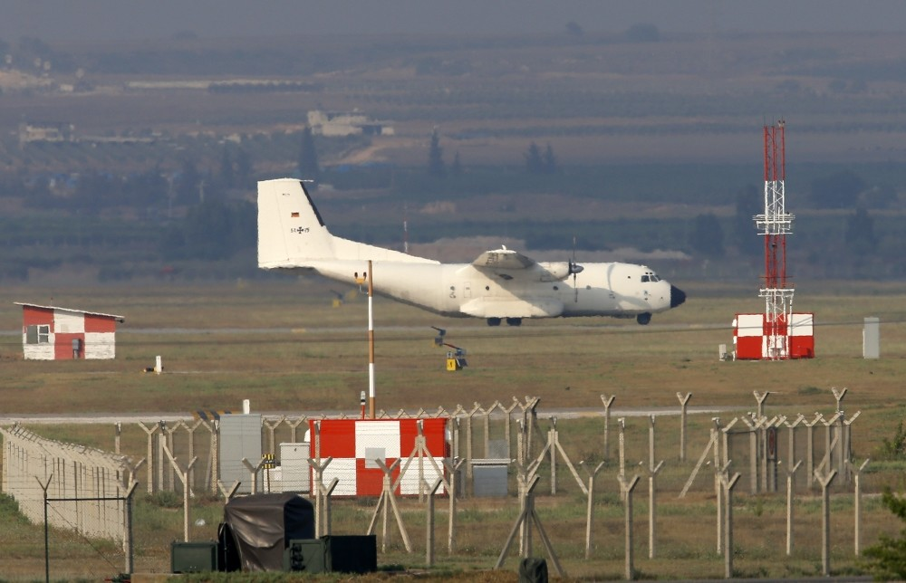 A German Air Force cargo plane maneuvers on the runway after it landed at the Incirlik Air Base, in the outskirts of the city of Adana, southern Turkey in July 29, 2015.