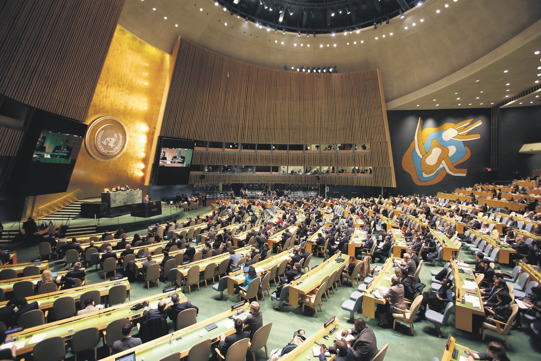 People gather at the General Assembly, prior to a vote, Thursday, Dec. 21, at the United Nations headquarters.