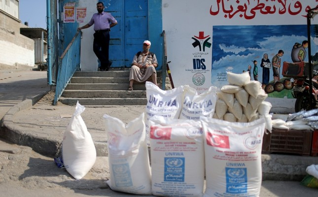 A Palestinian man sits outside an aid distribution center run by United Nations Relief and Works Agency (UNRWA) in Khan Younis in the southern Gaza Strip September 1, 2018. (Reuters Photo)