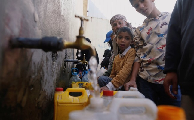People collect drinking water from a charity tap amid fears of a new cholera outbreak in Sanaa, Yemen, Nov. 5.