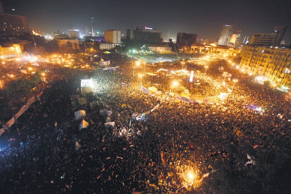 Demonstrators take part in a protest marking the first anniversary of Egypt's uprising in Tahrir square in Cairo, Jan.25, 2012.