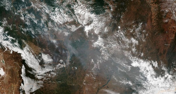 This August 21, 2019, satellite image obtained courtesy of the National Oceanic and Atmospheric Administration (NOAA) shows the smoke of several fires in the Brazilian states of Amazonas of Mato Grosso (bottom R) and Rondonia (bottom C). (AFP Photo)