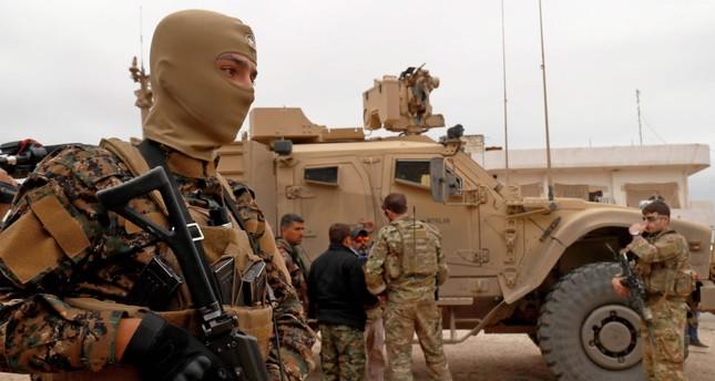 U.S. forces patrol the YPG-held town of Al-Darbasiyah, which borders Turkey, in northeastern Syria, Nov. 4.
