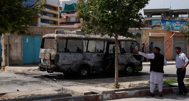 Security personnel inspect the site of a blast in Kabul, Afghanistan, Monday, June 3, 2019. (AP Photo)