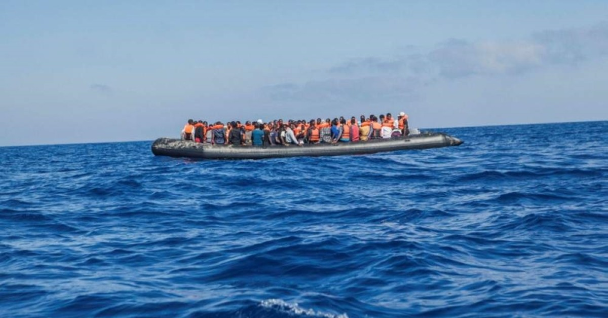 A rubber boat with 129 migrants on board, among them 60 women, is seen sailing out of control about 15 miles north of al Khums, Libya, on Tuesday, Aug. 1, 2017. (AP Photo)
