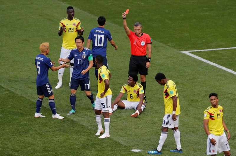 Referee Damir Skomina from Slovenia shows a red card to Colombia's Carlos Sanchez, on the ground, during the group H match between Colombia and Japan at the 2018 soccer World Cup in the Mordavia Arena in Saransk, Russia, June 19, 2018. (AP Photo)