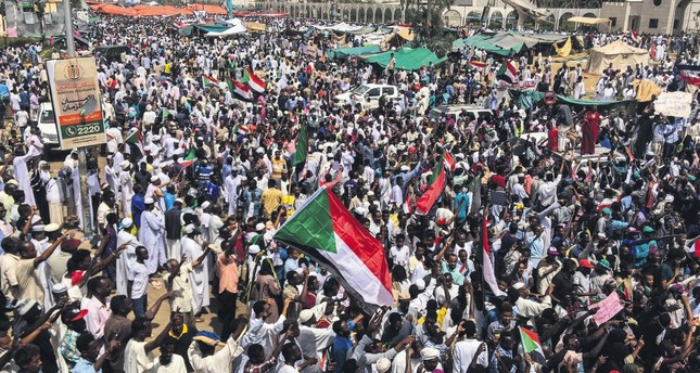 Demonstrators rally against military rule in Sudan's capital, Khartoum, April 12, 2019.