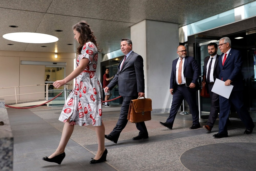 Turkish Deputy Foreign Minister Sedat u00d6nal (2nd L) leaves after a meeting with U.S. Deputy Secretary of State John Sullivan at State Department in Washington, Aug. 8.