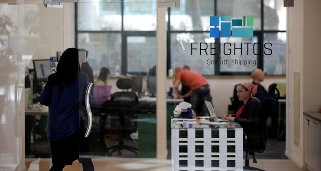 A woman enters the offices of Freightos, an online marketplace for international shipping, with investors including Sadara Ventures.