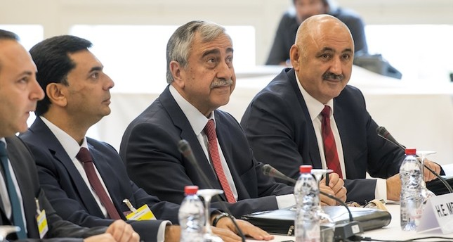 The Turkish Cypriot delegation with Turkish Cypriot leader, Mustafa Akinci, center, is pictured at the beginning of a new round of the conference on Cyprus under the auspices of the United Nations, in Crans-Montana, Switzerland. AP Photo