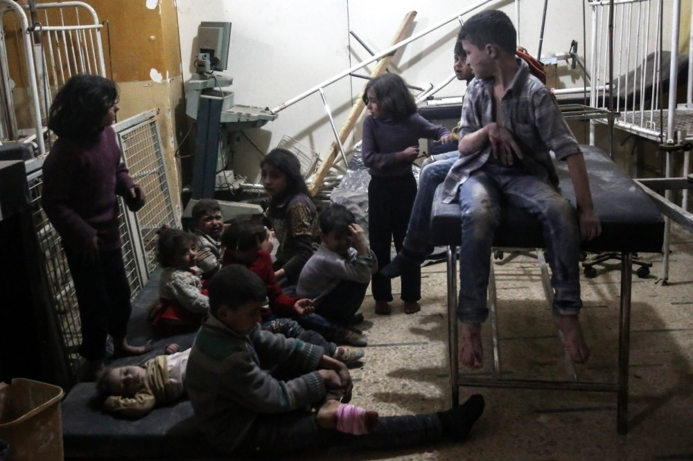 Injured Syrian children wait to receive treatment in a field hospital after airstrikes by the Assad regime on the moderate Syrian opposition-held Douma, Syria, April 4. (EPA Photo)