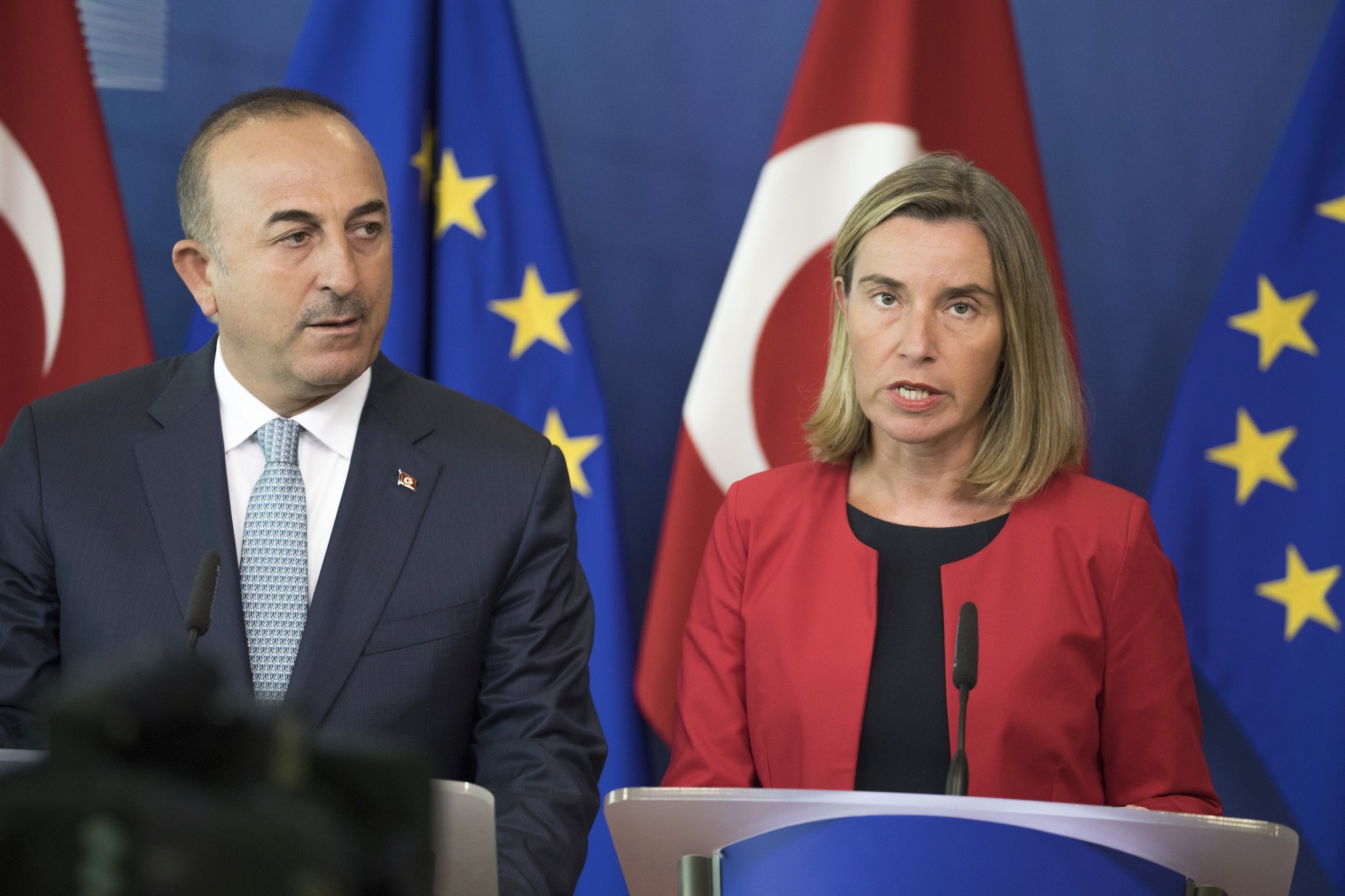 Foreign Minister Mevlu00fct u00c7avuu015fou011fu, and High Representative of the EU for Foreign Affairs and Security Policy Federica Mogherini, speak at a press conference in Brussels. (AP Photo)