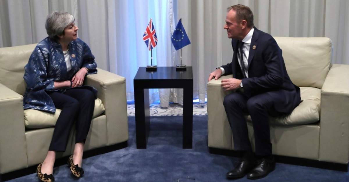 EU Council President Donald Tusk speaks with British PM Theresa May during a bilateral meeting on the sidelines of a summit of EU and Arab leaders at the Sharm El Sheikh convention center in Egypt, Sunday, Feb. 24, 2019. (AP Photo)