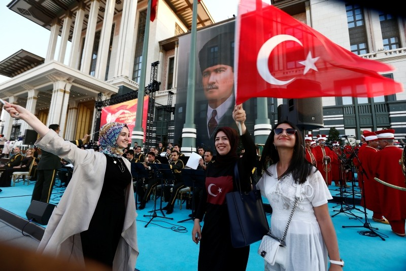 Supporters of President Erdoğan, pose for photographs following a ceremony at the Presidential Complex July 9, 2018.