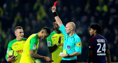 pThe French soccer federation suspended referee Tony Chapron until further notice on Monday after the official kicked a player during a league match./p  pThe federation said Chapron will be...