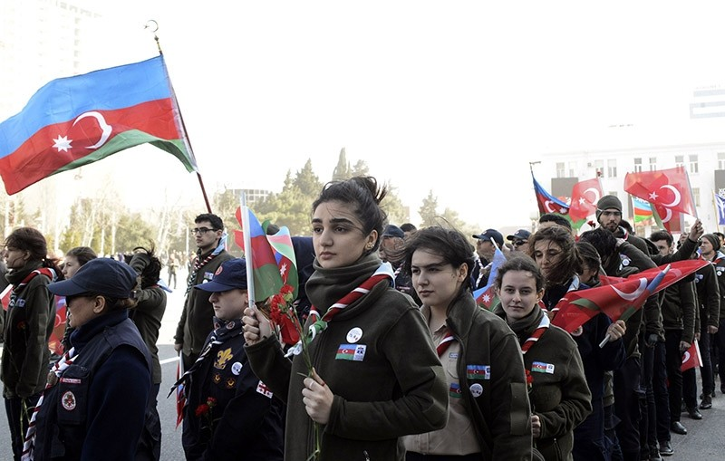 People attend a rally on Feb. 26, 2017 in Baku, capital of Azerbaijan, to mark the 25th anniversary of the Khojaly Massacre of Azerbaijanis by invading Armenian forces in Karabakh in 1992. (AFP Photo)