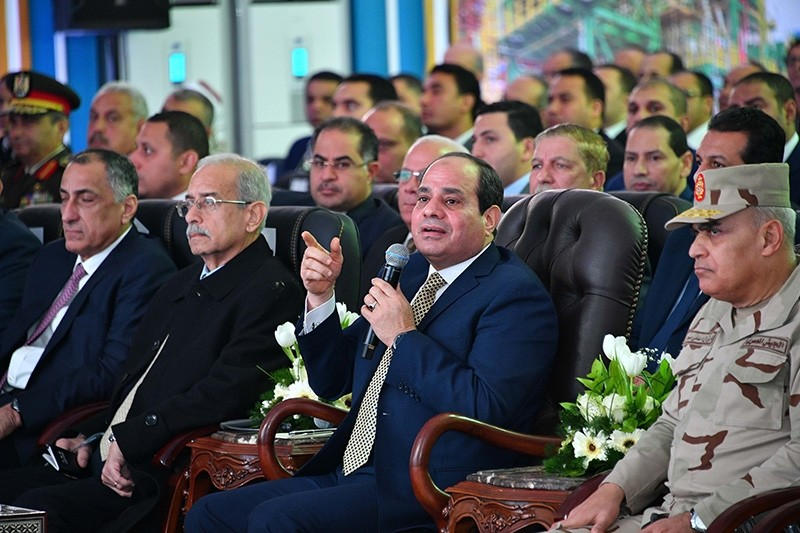 A handout picture released by the Egyptian Presidency on Jan. 31, 2018, shows Egyptian President Abdel Fattah al-Sisi (C) speaking as he attends an official ceremony for the inauguration of the offshore Zohr gas field. (AFP Photo)