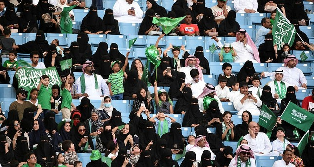 Saudi families sit in a stadium waving national flags, to attend an event in the capital Riyadh on September 23, 2017 commemorating the anniversary of the founding of the kingdom. (AFP Photo)
