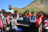 Visually-impaired boy gives concert at village school