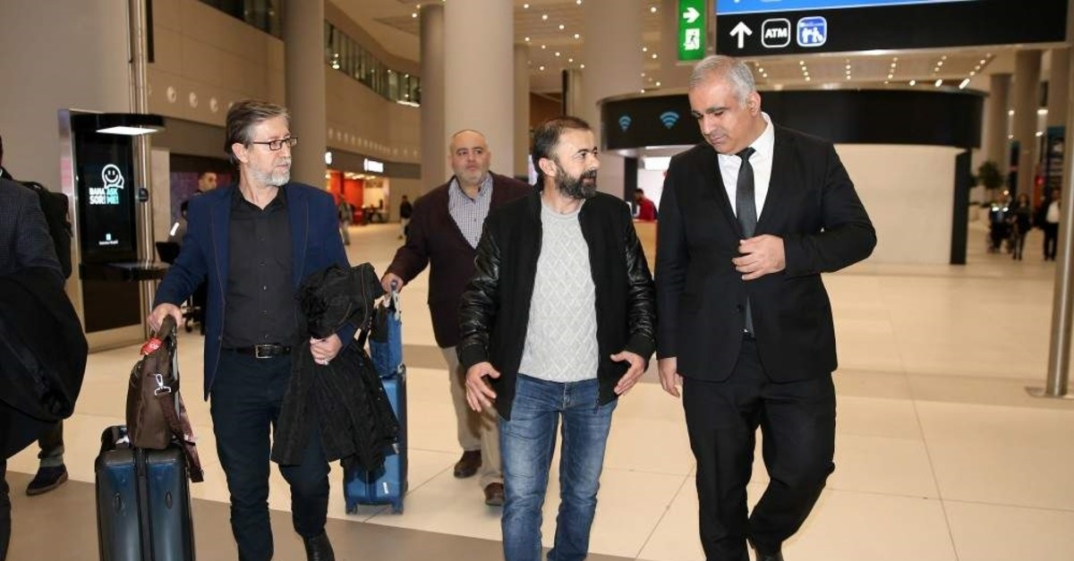 Hilmi Balcu0131 was greeted by Anadolu Agency officials upon his arrival at Istanbul Airport, Jan. 17, 2020. (AA Photo)