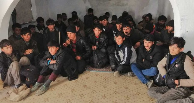 A group of illegal migrants huddled together in an abandoned building in the eastern province of Van. They were discovered hiding there by police on May 1, 2019, after sneaking into Turkey.