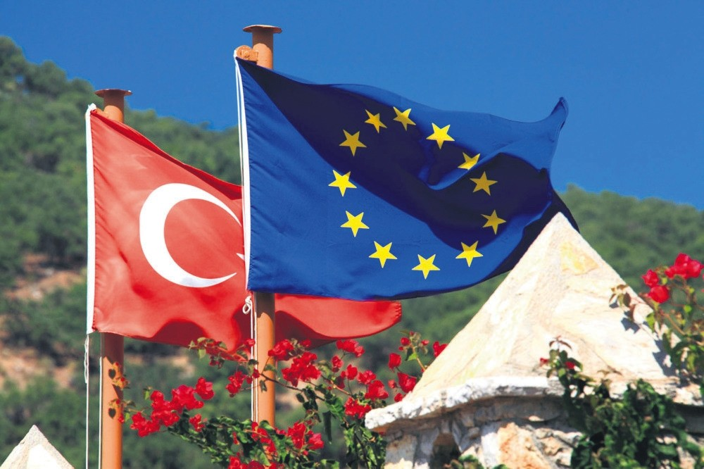 The flags of Turkey and the European Union flutter in the breeze.