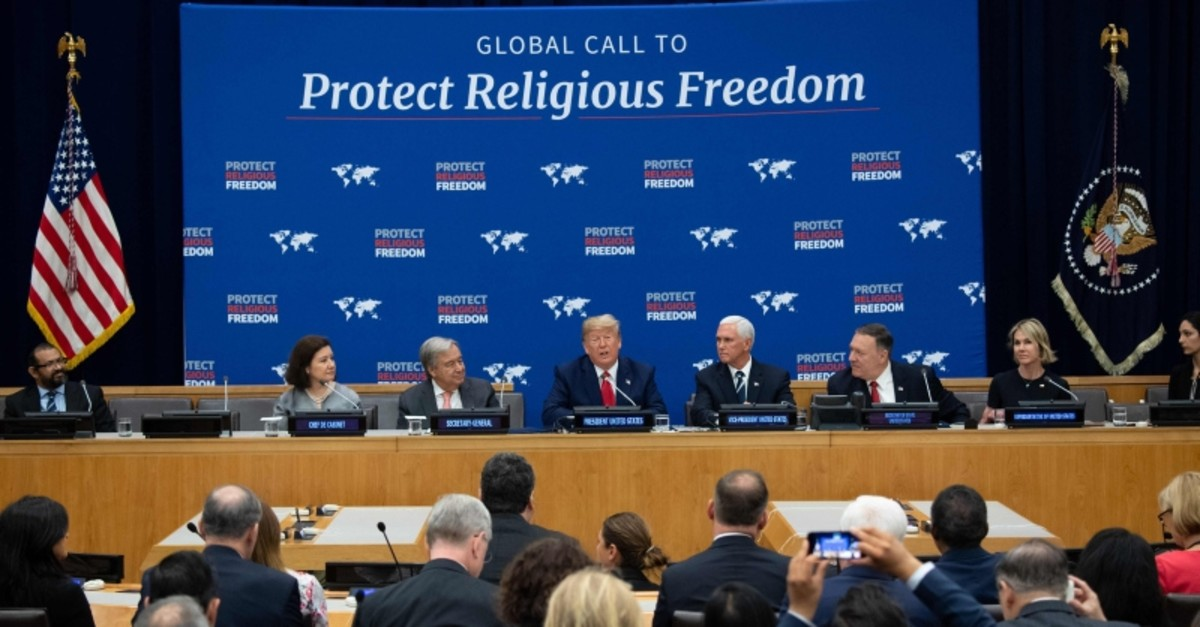 US President Donald Trump (C) speaks alongside US Vice President Mike Pence (R) and UN Secretary General Antonio Guterres (L) at a United Nations event on Religious Freedom at UN Headquarters in New York, Sept. 23, 2019 (AFP Photo)