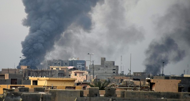 Smoke rises from Daesh positions following a U.S.-led coalition airstrike as Iraqi Security forces advance their position in downtown Ramadi, 70 miles 115 kilometers west of Baghdad, Iraq, Tuesday, Dec. 22, 2015.  AP Photo