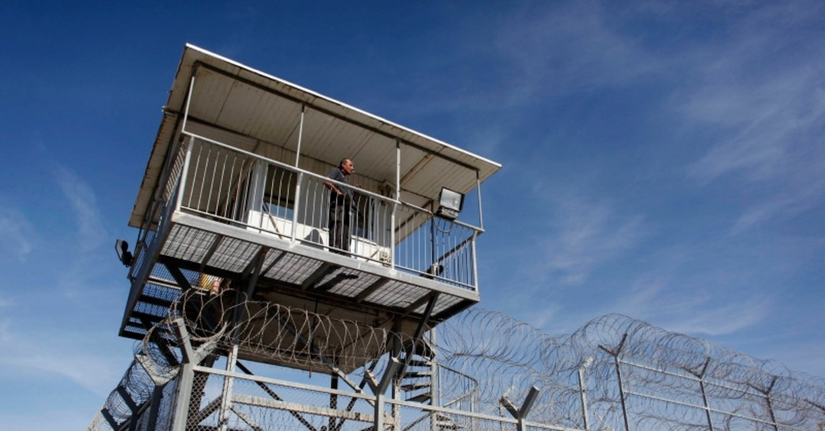 A prison guard keeps watch from a tower at Ayalon prison in Ramle near Tel Aviv, Israel, Feb. 13, 2013. (Reuters Photo)