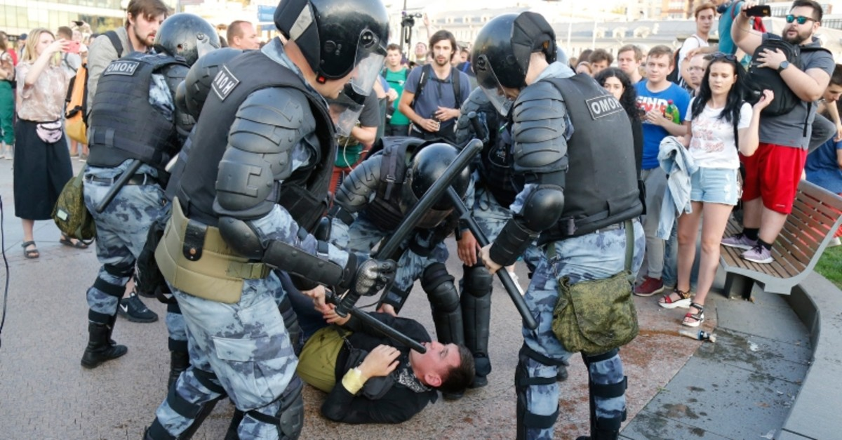 Police officers detain a man during an unsanctioned rally in the centre of Moscow, Russia, Saturday, July 27, 2019. (AP Photo)