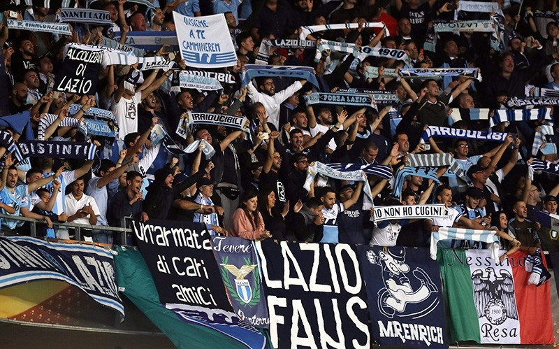 Lazio's supporters celebrate their team's victory at the end of the UEFA Europa League football match between Nice and Lazio on October 19, 2017, at the Allianz Riviera stadium in Nice, southeastern France. (AFP Photo)